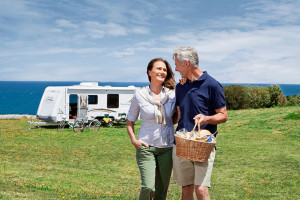 Older couple looking healthy with their new caravan